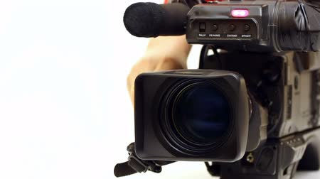 camera operator : TV camera ; Beta-cam camcorder lens close-up in zoom processing and switched shooting,video clip
