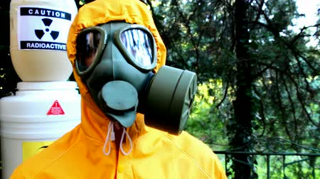 veneno : Equipment for chemical and biological protetcion;Chemical technician equipped with a protective suit and gas mask,fly cam video clip