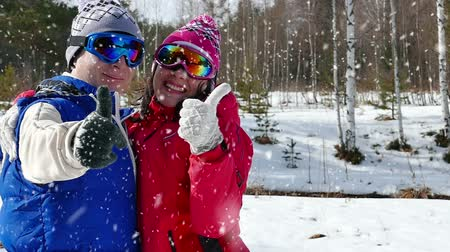 sporty zimowe : Young couple is looking forward to the snow and rising thumb up,slow motion video clip