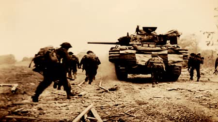 military tank : Allied soldiers advancing on battlefield ; Normandy, France-1944 ; Allied soldiers advancing on battlefield, Normandy, France, archival footage Stock Footage