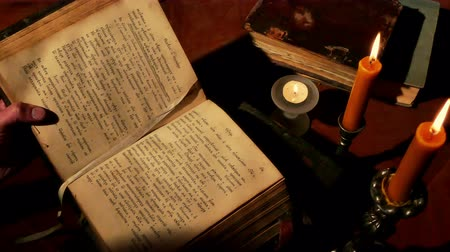 cassock : Zrenjanin ;Serbia; 03032017.Old Christian liturgical book. Printed in Venice in 1765 year ; Reading Old Book Under Candlelight Stock Footage