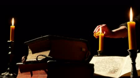 cassock : Old Books and Candlelight ; Old books on the table monastery Reading Room lighted candlelight