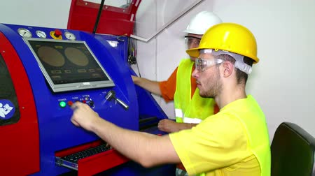 Control panel of the engine room ; The machine technician performs computer control of the working machine