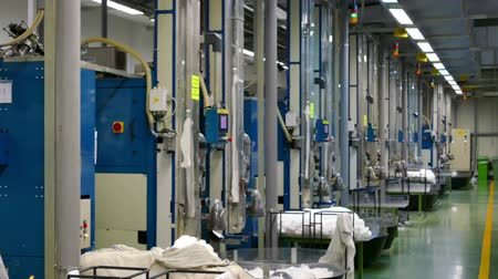 чулки : Factory hall with modern machinery in the textile industry ; Machine in the process of producing female nylon socks