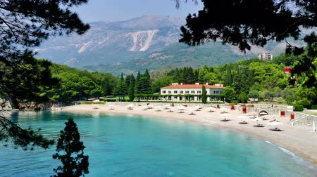 parasol : View of the beautiful Saint Stephens beach ; View of the beautiful Saint Stephens beach in Montenegro,