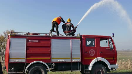 bleeding : Zrenjanin ; Serbia ; 22.11.2017. Two firefighters extinguished the fire with water cannon from a fire truck