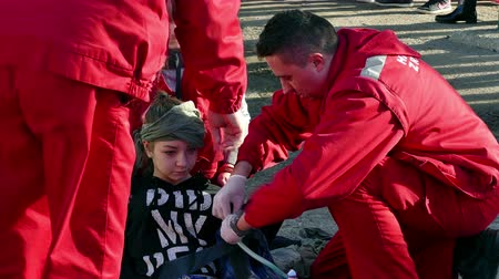 first officer : Zrenjanin ; Serbia ; 22.11.2017.Provides first aid to rescue services in case of traffic accidents-demonstration exercise. Stock Footage