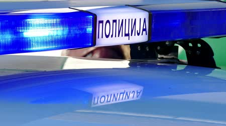 Zrenjanin ; Serbia ; 22.11.2017. Blinking blue lights on a police car at the scene of a traffic accident.Cyrillic inscription