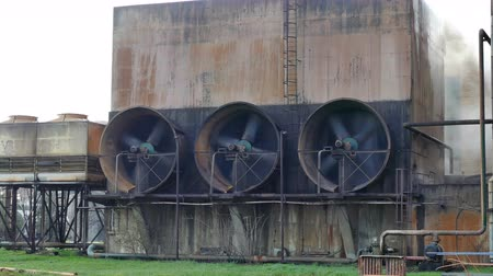 neglected : Large fans at the Industrial Plant ; Huge old Propellers working on the wall of the factory