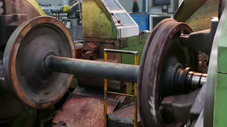 lasca : Processing Axles of Rail Vehicles on a Large Lathe  Large lathe processing metal parts for rail vehicles