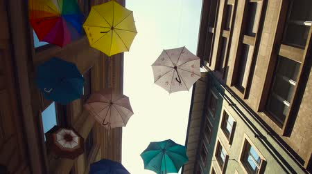 Umbrellas from below in an alley