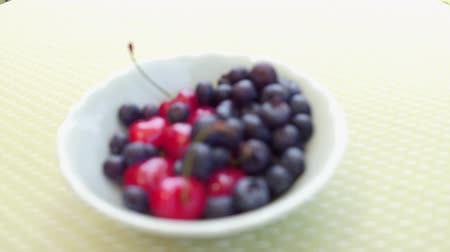 delicious cherries in a white bowl