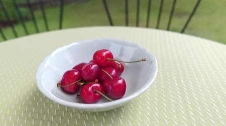 borůvka : delicious cherries in a white bowl