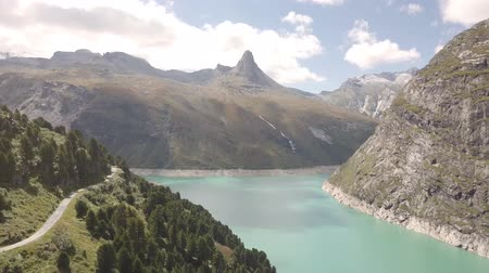 valais : a Swiss reservoir in the Alps with a striking mountain peak in the background Stock Footage