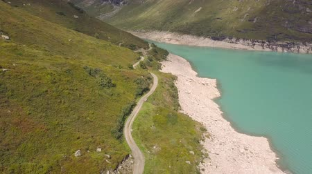 valais : Drone flight over a reservoir with turquoise water
