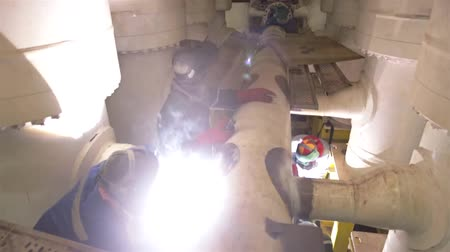 3 Workers Welding A Machine Pipe - Tilt