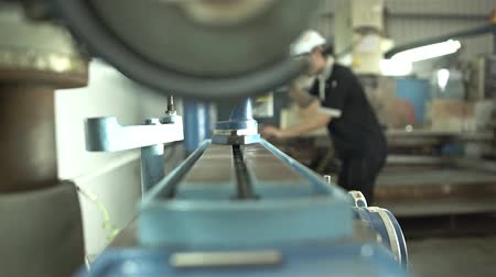 Factory Worker Using Blue Drill Machine - Slider - Left To Right Stock Footage