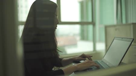 Girl Working On Laptop - Slider - Right To Left Stock Footage