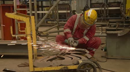 Worker In Red Cloths Grinding Metal - Slider - Left To Right