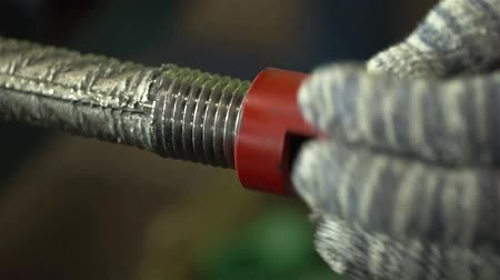 Worker Putting Red Coupler On A Construction Steel Bar - Close Up Stock Footage