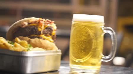 tapioca : Beef Bacon Cheese Burger With French Fries And Beer With Bubbles - Pan - Right To Left Stock Footage