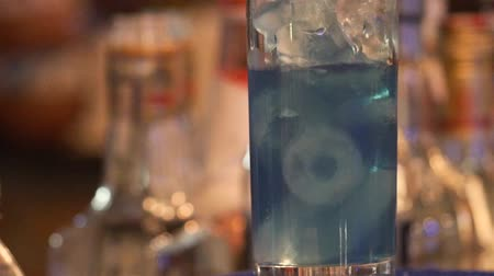 Pouring Blue Drink In A Transparent Glass Full Of Ice - Close Up