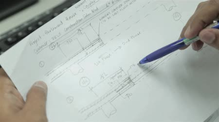 Going Through Engineering Notes On White Paper - Close Up Stock Footage