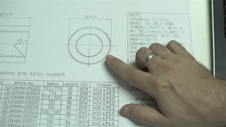 Hands Pointing To Design In Blue Print Stock Footage
