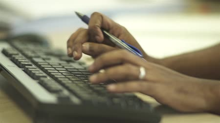 Man Typing On Black Keyboard - Close Up