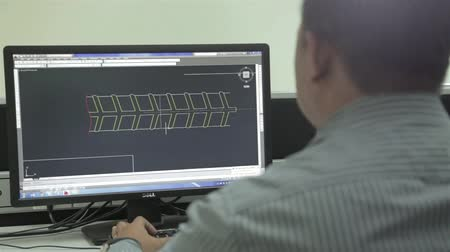 kl : Man Working On Auto Cad Engineering Software - Slider - Right To Left Stock Footage