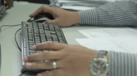 Man Working On Black Keyboard And Mouse - Side Angle - Close Up Stock Footage