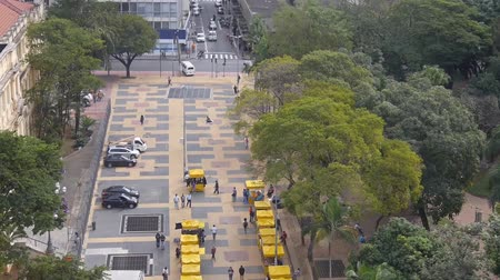 crossing road : A Market With Yellow Tops From Top - Tilt Towards Buildings