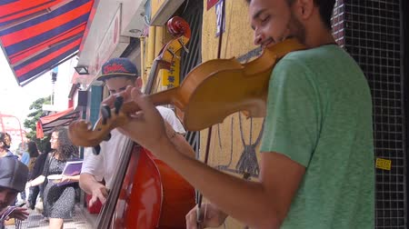 busking : 2 Guys Busking On Street - Playing Violin & Cello -  Side Angle