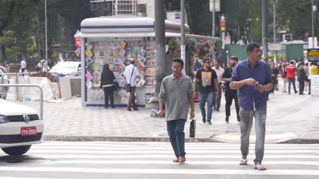 busking : Asian Man With Black Bag Crossing The Road Stock Footage