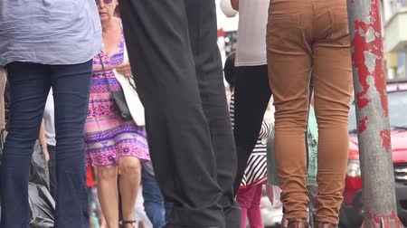 busking : Legs Of People At A Busy Street - Low Angle Stock Footage