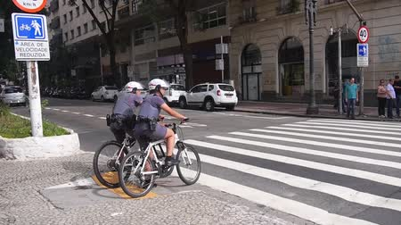 Sao Paulo - Police On Bicycle Wearing Shorts Waiting On A Signal