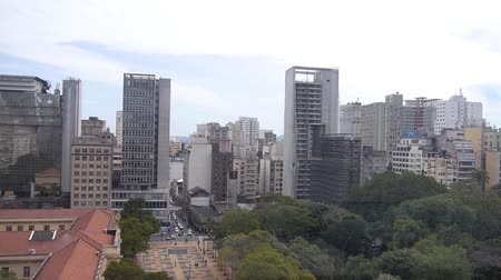 busking : Sao Paulo City - Surrounded By Buildings - Pan - Right To Left