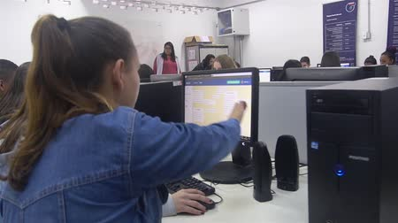 tab : Girl Wearing Blue Jeans Jacket Pointing To Computer Screen