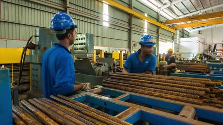 Blue Cap Workers Cutting Metal Rods - Timelapse - Tilt