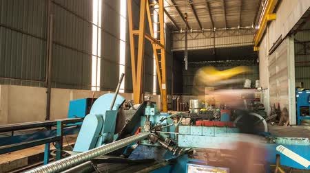 Machine Cutting Long Aluminium Pipes - Timelapse - Tilt Stock mozgókép