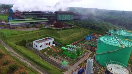 Top View of Palm Oil Plantation Factory - Aerial - Moving Down And Towards Stock mozgókép