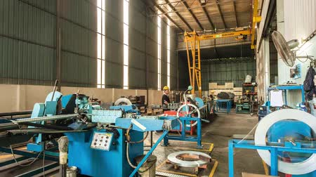 Yellow Safety Cap Workers Working On Machines - Timelapse - Tilt