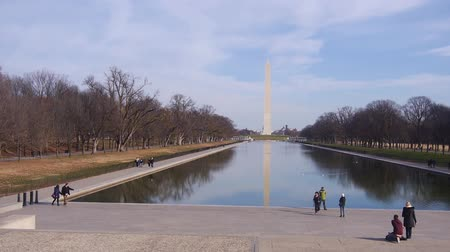 metro : People Walking Near Water Source, Trees And Monument - Static
