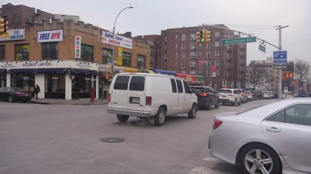 bronx : Cars At Busy Road Intersection - Pan - Right To Left