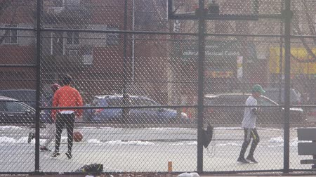south asian food : Men Playing Basketball Behind Fence - Static