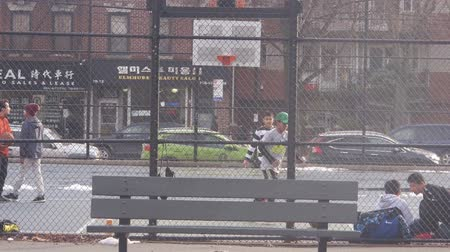 south asian food : Men Playing Basketball Behind Fence And Bench - Static