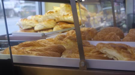 bronx : Warm Croissants Behind Food Shop Showcase - Slide - Right To Left