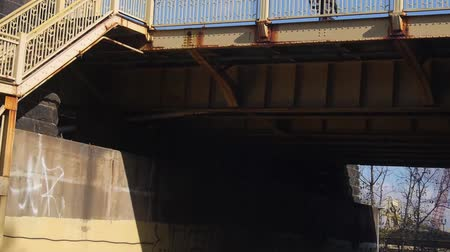 descobrir : Passing Under Bridge On Road - Slide Forward Stock Footage