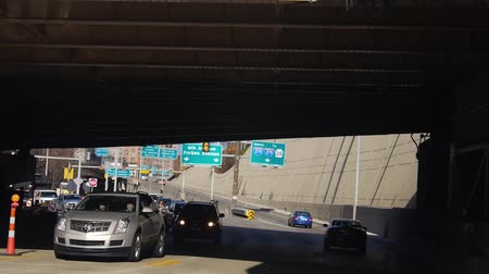 sight seeing : Passing Under Bridge On Road Near Buildings - Slide Forward