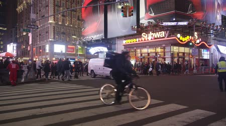 kereszt : Cars, People And Bicycle Crossing Busy Street At Night - Pan - Right To Left